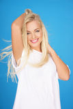 Beautiful young blond with a vivacious smile Stock Images