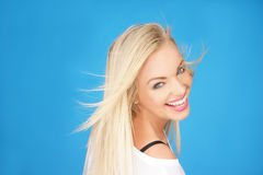 Beautiful young blond with a vivacious smile Royalty Free Stock Image
