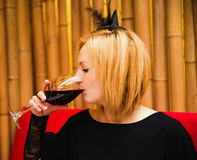 Beautiful young blond witch in a cafe on a holiday Halloween Royalty Free Stock Photography
