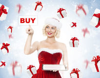 Beautiful young blond woman as santa girl Stock Images