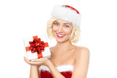 Beautiful young blond woman as santa girl with gift Stock Photography