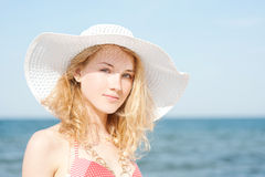 Beautiful young blond woman with beach hat Stock Photo