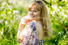Beautiful young blond woman. Beautiful young blonde woman with sunglasses in the summer sundress Royalty Free Stock Photo