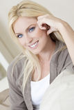 Beautiful Young Blond Woman With Blue Eyes Stock Photo