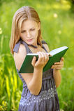 Beautiful young blond woman with book Stock Image
