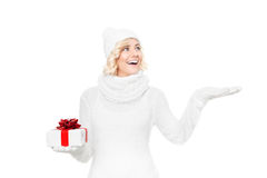 Beautiful young blond woman with christmas gift Royalty Free Stock Image