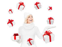 Beautiful young blond woman with christmas gift Royalty Free Stock Images