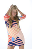 Sexy fashio pose. Beautiful young blond woman in a dress Royalty Free Stock Image