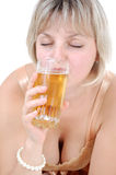 Beautiful young blond woman drinking beer Stock Photography