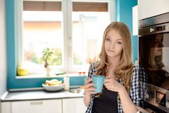 A beautiful young blond woman drinking tea Stock Images