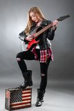 Beautiful young,blond woman with a electric guitar Royalty Free Stock Image