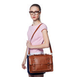 Beautiful young blond woman with glasses in an office-style business bag on her shoulder. Isolated on white background Royalty Free Stock Image