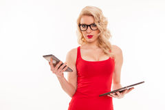 Beautiful young blond woman with glasses in red t-shirt holding Royalty Free Stock Photography