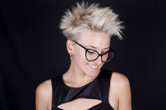 Beautiful young blond woman with glasses and a stylish black shi royalty free stock photo
