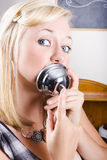 Young Blonde Woman Ringing The Bell Of Lip Service Royalty Free Stock Image
