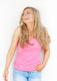 Beautiful young blond woman laughing and looking up Stock Image
