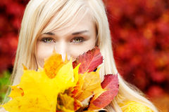 Beautiful Young blond woman with leafs royalty free stock images