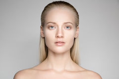 Beautiful Young Blond Woman With Long Slicked Hair. Portrait Of A Beautiful Young Blond Woman With Long Slicked Hair Royalty Free Stock Photography