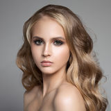 Beautiful Young Blond Woman With Long Wavy Hair. Portrait Of A Beautiful Young Blond Woman With Long Wavy Hair Royalty Free Stock Photos