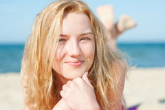Beautiful young blond woman lying on a beach Royalty Free Stock Photo