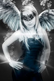 Beautiful young blond woman with mask, sensual and sexy winged r Stock Photo