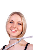 Beautiful young blond woman measuring her body royalty free stock images