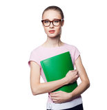 Beautiful young blond woman in an office style holding a folder. Isolation on a white background Royalty Free Stock Photos
