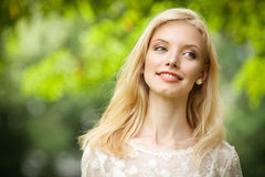 Beautiful Young Blond Woman Outdoors Stock Photo