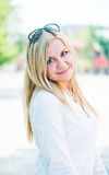 Beautiful young blond woman outdoors Stock Photography