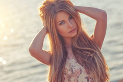 Beautiful young blond woman outdoors portrait near the sea Royalty Free Stock Photos
