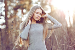Beautiful young blond woman outdoors portrait Stock Photos