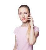 Beautiful young blond woman on the phone. Isolation on a white background Royalty Free Stock Image
