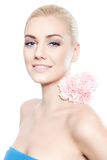 Beautiful young blond woman with pink flower Stock Photos