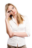 Beautiful young blond woman pondering. Royalty Free Stock Images