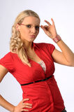 The beautiful young blond woman in the red shirt Royalty Free Stock Photo
