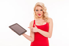 Beautiful young blond woman in red t-shirt holding a tablet comp Royalty Free Stock Photo