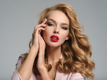 Beautiful young blond woman with red lips. royalty free stock photos