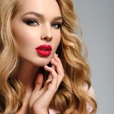 Beautiful young blond woman with red lips. royalty free stock photography
