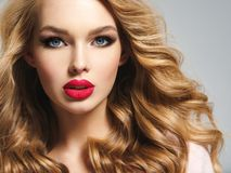 Beautiful young blond woman with red lips. stock photos