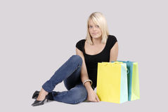 Beautiful young blond woman with shopping bags Stock Image