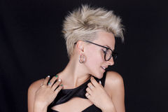 Beautiful young blond woman with short hair with glasses in prof Royalty Free Stock Image