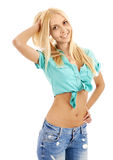 Beautiful young blond woman smiling and touching her hair Stock Image