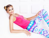 Woman with sparkling silver makeup and colourful clothes. Beautiful young blond woman with sparkling silver makeup and colourful clothes posing in the studio stock photos