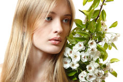 Beautiful young blond woman with spring flowers Royalty Free Stock Photo