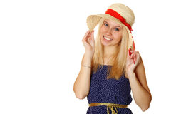 Beautiful young blond woman in a straw hat Royalty Free Stock Photos