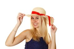 Beautiful young blond woman in a straw hat Royalty Free Stock Images