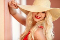 Beautiful young blond woman in a straw hat Stock Images