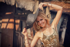 Beautiful young blond woman with sun hat. Royalty Free Stock Photo