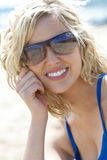 Beautiful Young Blond Woman in Sunglasses Smiling Royalty Free Stock Image