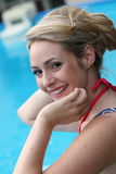 Beautiful young blond woman swimming in a pool Stock Image